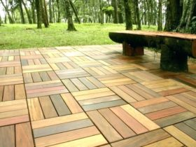 composite interlocking patio tiles on grass in the backyard