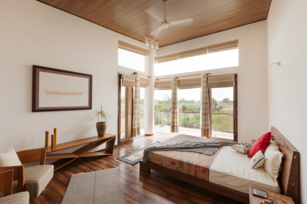 light-color hobbled reed roman shade in a contemporary bedroom