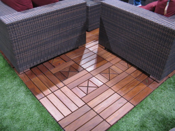 the use of interlocking composite deck tiles to create patio on grass