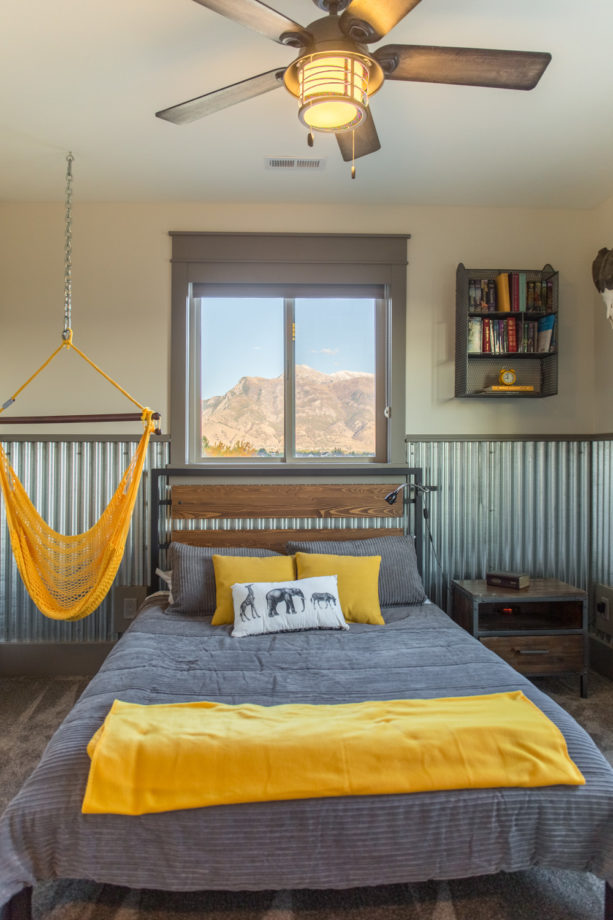 a kid's bedroom with corrugated metal as the wainscoting