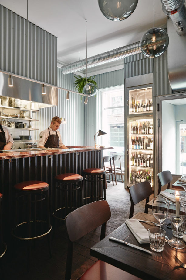 the use of corrugated metal panels on restaurant walls and bar
