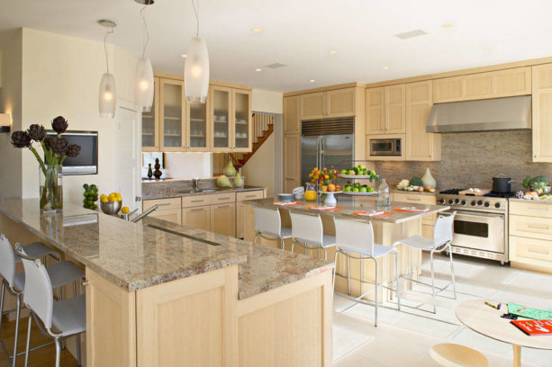 a beach style kitchen with maple cabinets and Linen White wall paint