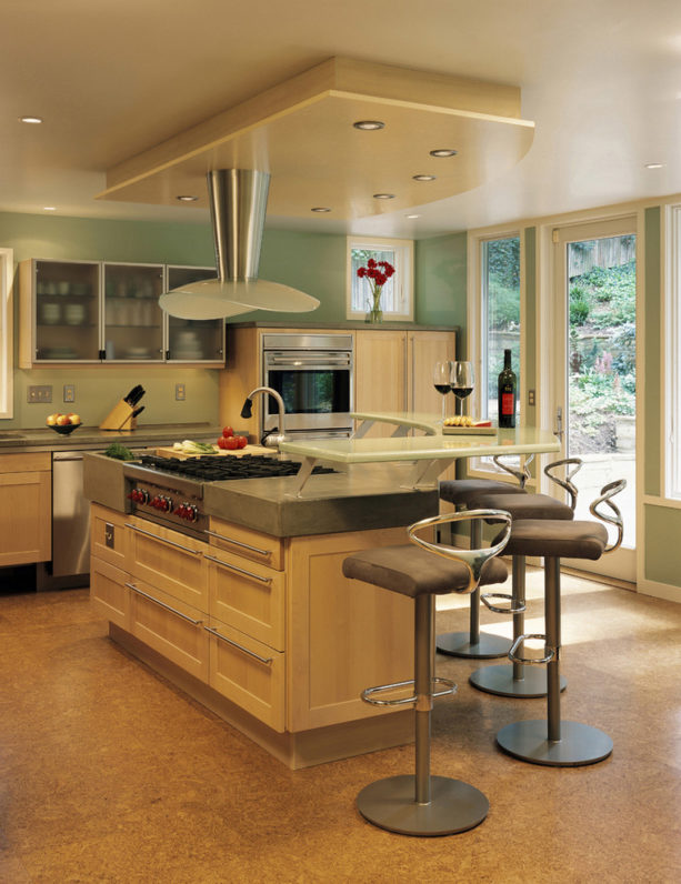 a contemporary kitchen with caramel maple cabinets and Seawashed Glass wall paint