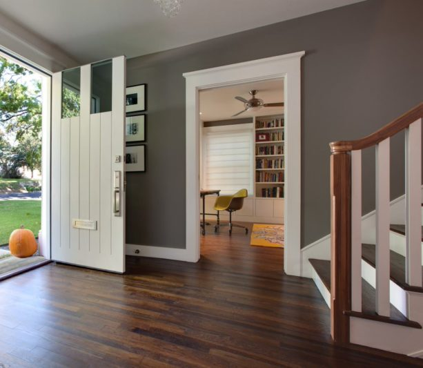 a traditional entry with white trim that seems to frame the dark wood floor