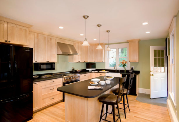 a traditional kitchen with natural maple cabinets and Kittery Point Green wall paint