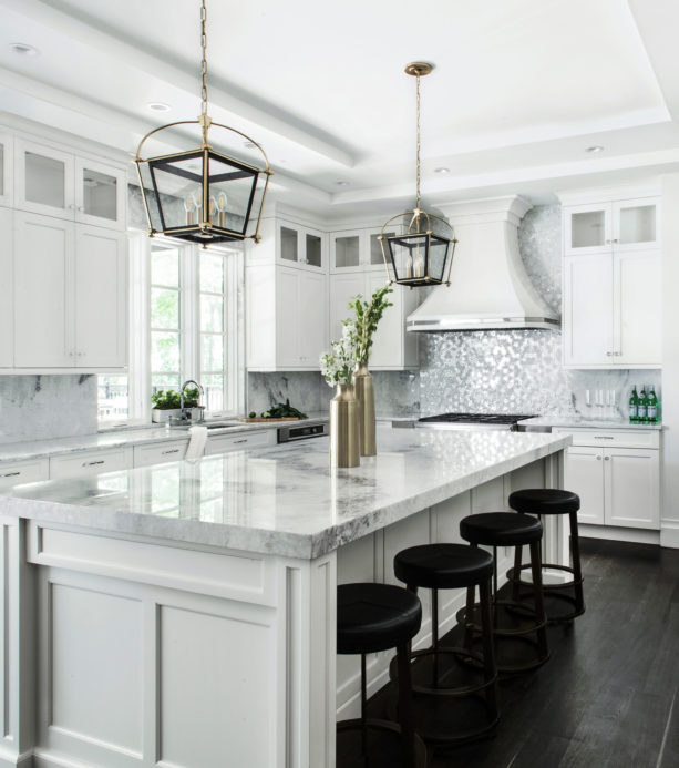 a traditional kitchen with white trim and dark-stained white oak floor