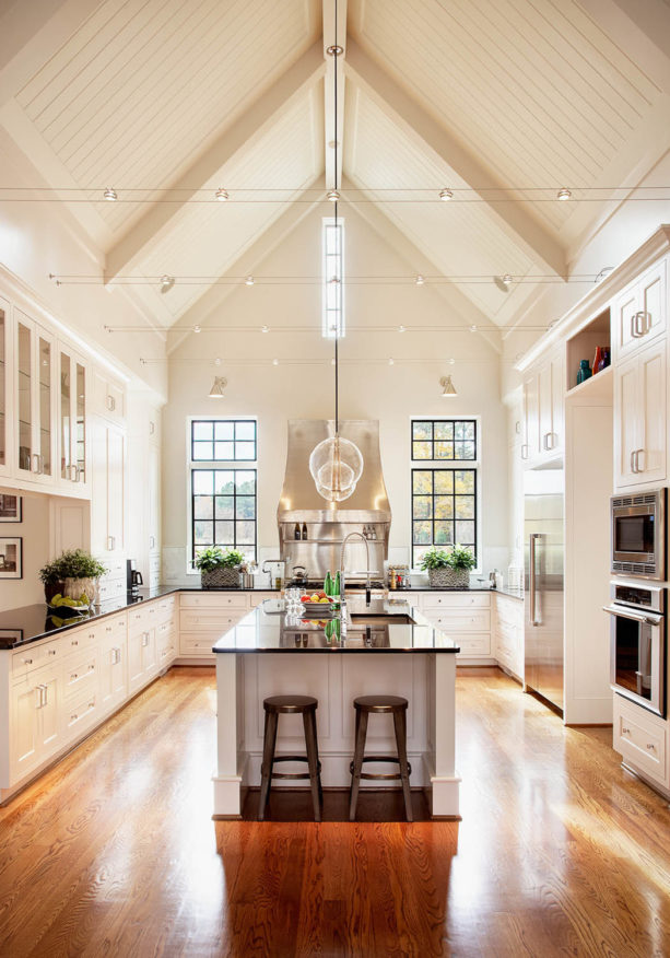 chic atmosphere in a traditional kitchen white medium tone wood floor and white trim