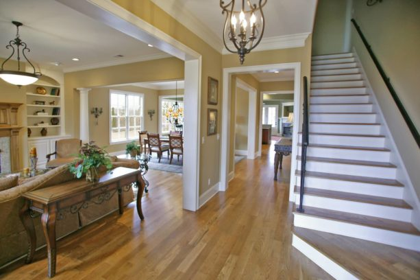 traditional interior with beige wall, white trim, and wood floor