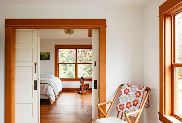 white sliding doors paired with an orangish wood trim