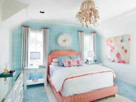 a coral and blue themed transitional bedroom with underwater feel