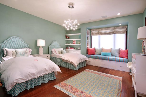 a delicate contemporary bedroom with greyish blue tone and coral accents