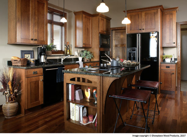 a traditional kitchen with glazed white oak, black appliances, and off-white wall paint