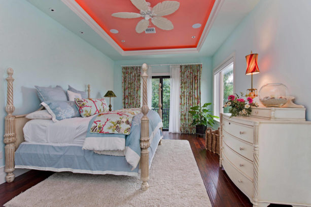 a tropical bedroom with coral, light blue, and off-white tones