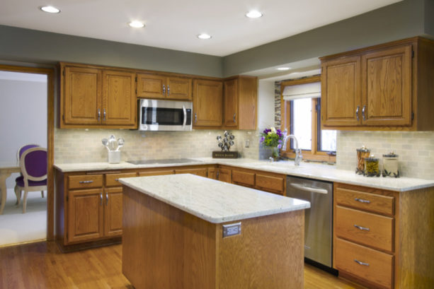 an eclectic kitchen with honey oak cabinets and benjamin moore coventry gray wall paint