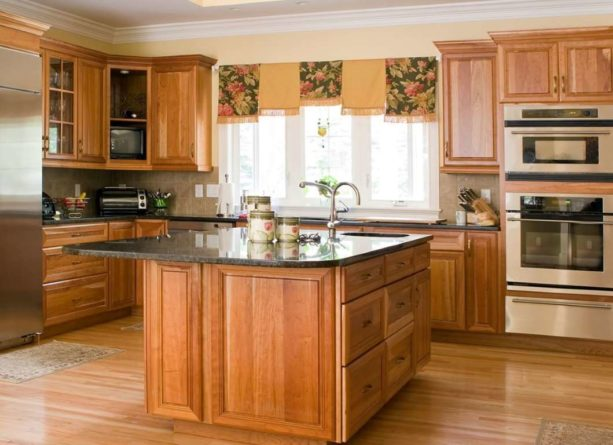 honey oak cabinets and pastel yellow wall paint combination