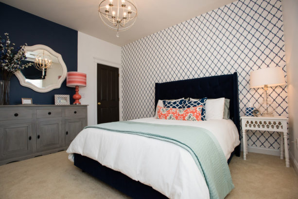 navy blue, coral, and grey accentsin a modern bedroom