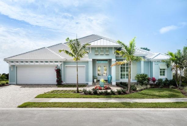 a beach-style light blue home exterior with white trim