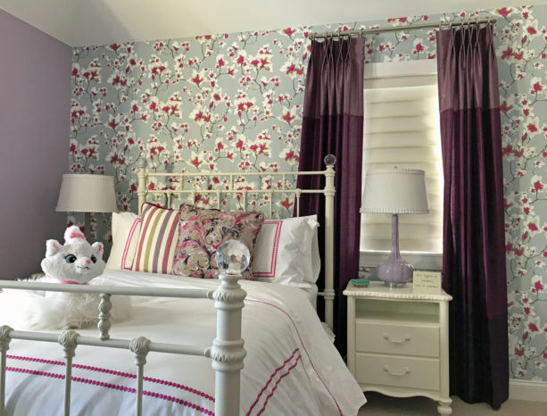 a gorgeous transitional girl's bedroom with deep pink, purple, grey, and white colors