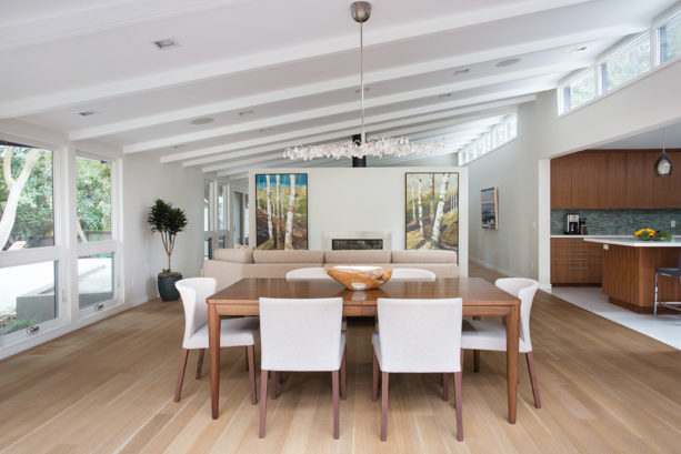 a mid-century modern dining room with clear-sealed maple floor