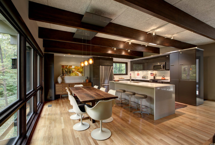 a mid-century modern kitchen dining with clear-coated quartered oak floor