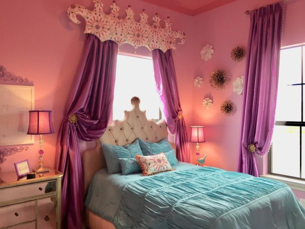 a princess bedroom with pink walls, purple curtains, and blue bedding