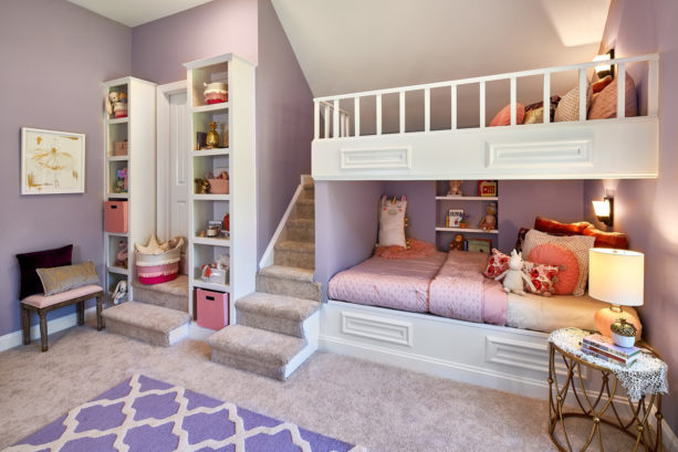 a traditional pink and purple shared bedroom for little girl and teen