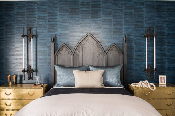 an eclectic bedroom with black, gold, and dark blue color scheme