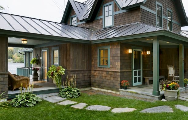 a rustic dark wood house with brown roof