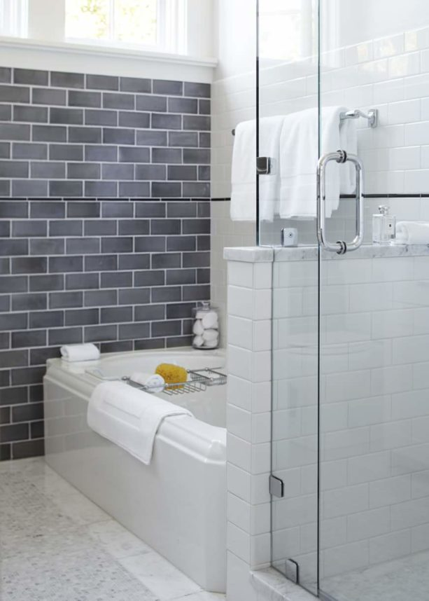 multi-color bathroom design with white subway tile and white grout