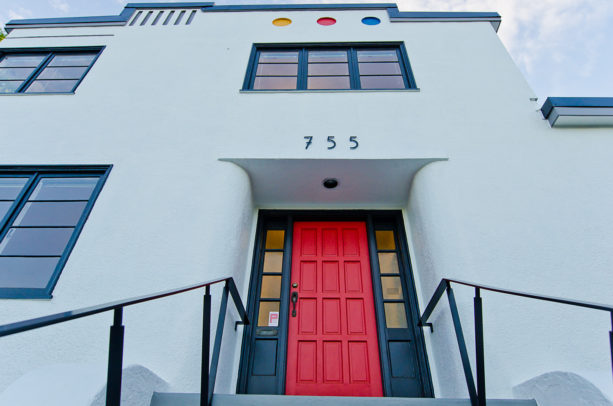 a bright red front door as a match for the black trim of a white house