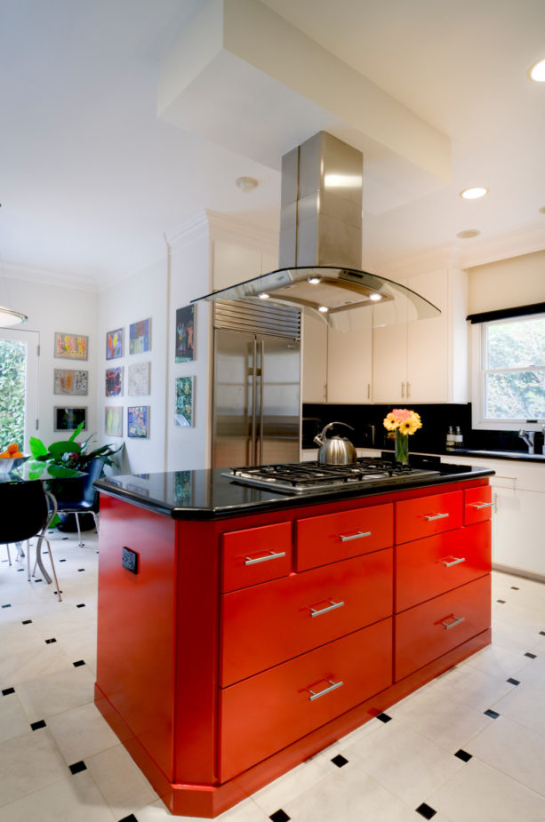 a contemporary kitchen with stunning red kitchen island with black top