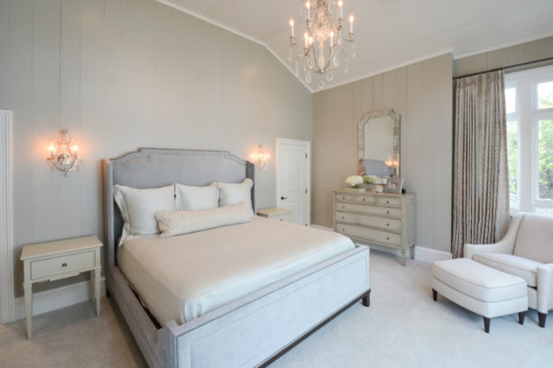 a transitional bedroom with white carpet flooring and light grey walls