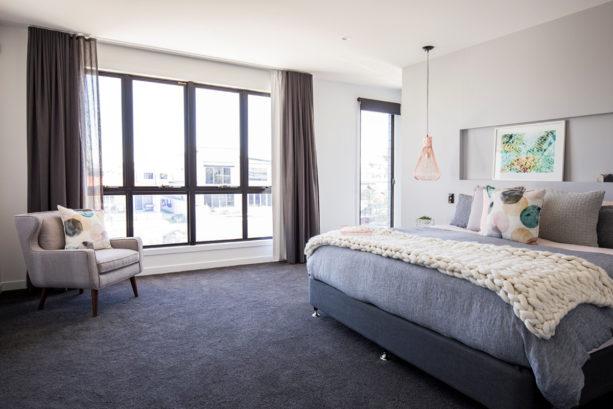 dark grey carpet in a contemporary bedroom with light grey walls