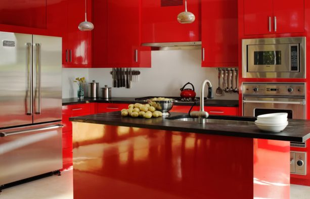 red and black kitchen design with stainless-steel appliances
