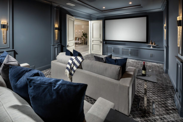 white-patterned grey carpet floor in a home theater with dark grey walls