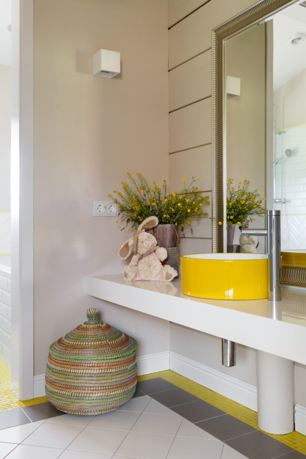 a round yellow sink in a contemporary warm grey bathroom
