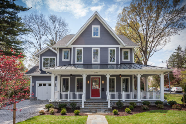 a traditional grey house with red door and white trim