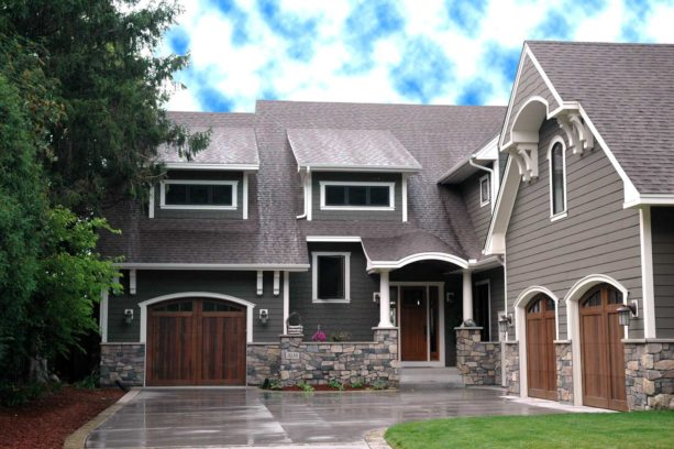 a traditional house with white trim and cozy wood accents from the doors