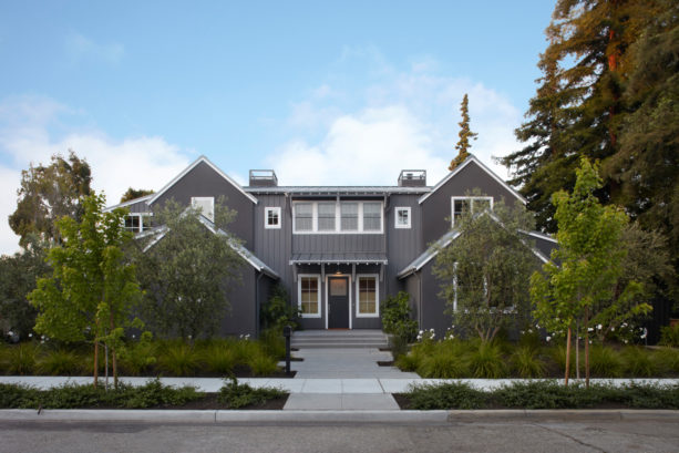 a transitional home exterior with dark gray siding and white trim