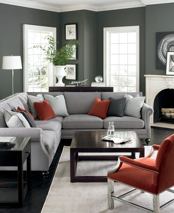 brick-red accents for creating a cozy atmosphere in a multi-grey living room