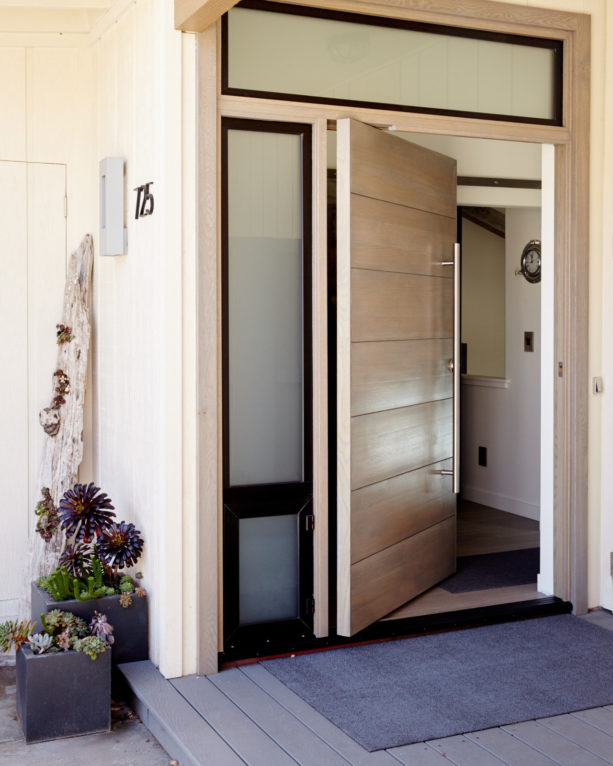 contemporary white oak Solace front door with custom frame and threshold by Pivot Door Company