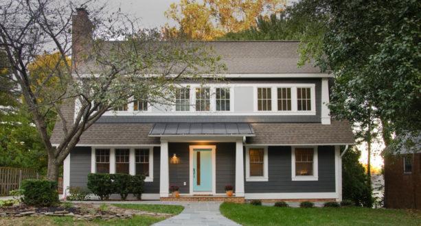 dark grey craftsman exterior with pastel blue front door