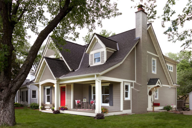 greige house, white trim, and red front door exterior design