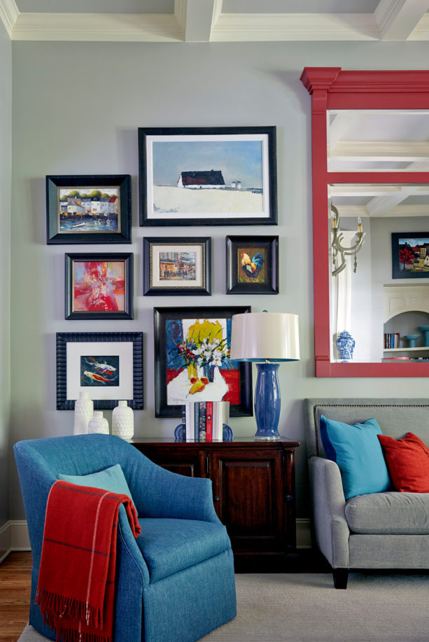 grey, blue, and red color scheme in a traditional living room