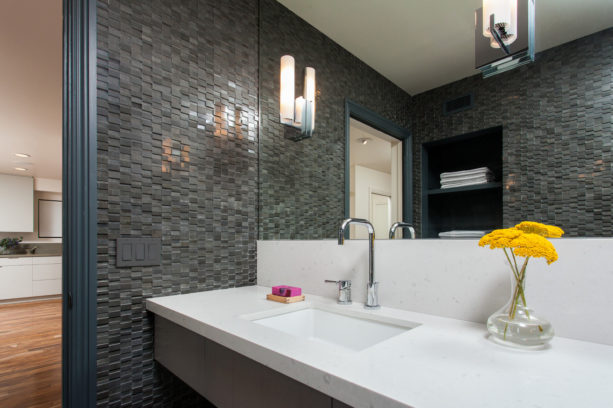 simple yet catchy flower decoration in grey bathroom with mosaic tile