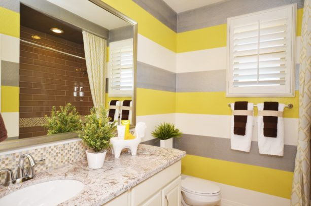 stripe bathroom wall design with yellow, white, and grey colors