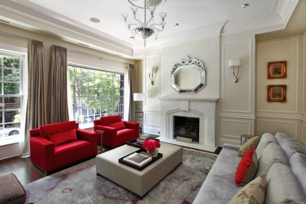 stunning red chairs in an eclectic living room with grey and beige colors