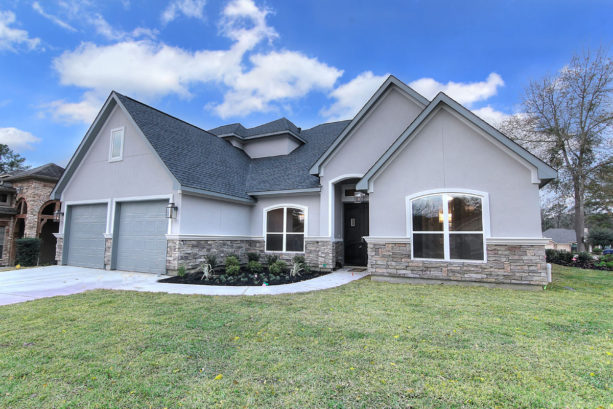 white trim and natural stone material in a lighter gray transitional exterior