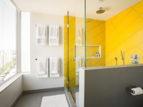 yellow shower room in a modern grey bathroom
