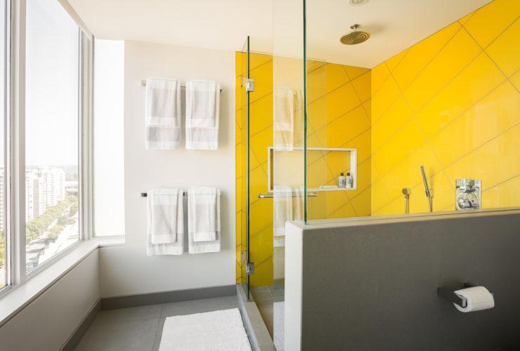 yellow shower room in a modern grey bathroom